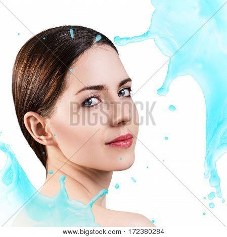Young woman face in splashes of water over white background. Moistening treatment concept.
