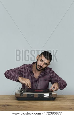 A man playing music using vinyl record instruments