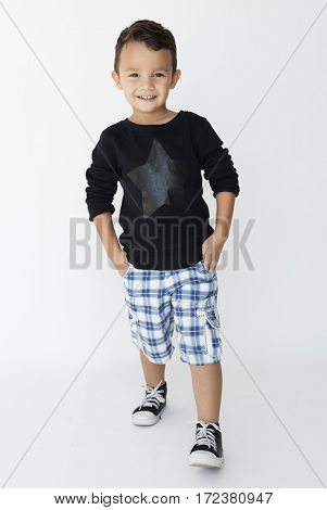 Caucasian boy is in a studio shoot.