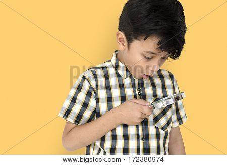 Little boy looking through magnifier