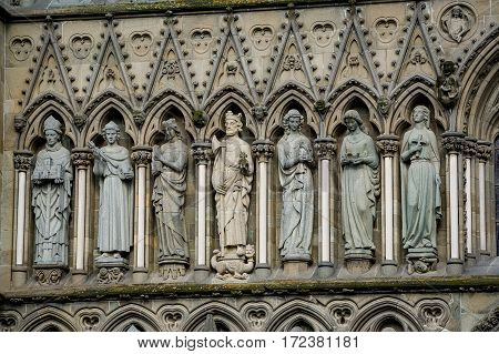 Nidaros ancient gothic cathedral close view at facade decoration with arcs, columns and statues. Nidarosdomen, Trondheim, Norway