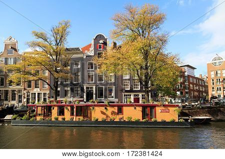 AMSTERDAM/ THE NETHERLANDS - OCTOBER 22, 2014. Residential houses along the Prinsengracht canal. Amsterdam, Netherlands