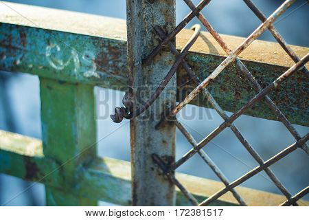 Rusty metal grille with paint residues. Overpass over the railway, Kirov, Russia.