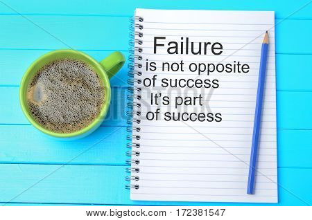 Failure is not opposite of success.Motivational quote on notebook