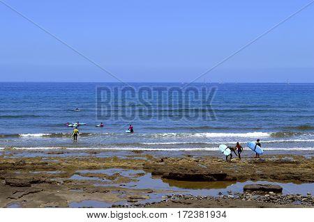 Playa De Las Americas beach Tenerife Canary Islands Spain Europe - June 12 2016 : Surfing on Playa De Las Americas beach