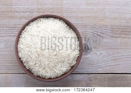 Japanese traditional food uncooked rice in a bowl on a wooden background