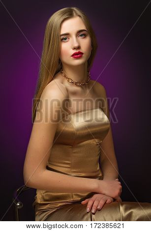 Blonde Girl In Gold. Classic Portrait. Blue Eyes And Red Lips. Chic