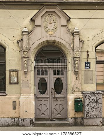 RIGA/ LATVIA - JULY 26. Door of the old apartment building built in 1905 in art Nouveau style on Pils street on July 26, 2015. Riga, Latvia.