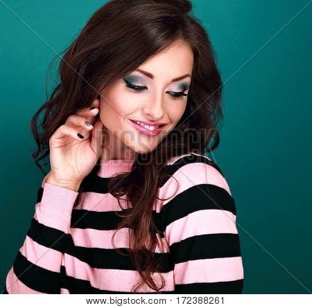 Beautiful Smiling Makeup Woman With Bright Color Eyeshadow Looking Down With Curly Long Hairstyle On
