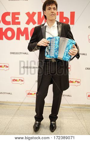 MOSCOW - OCT 9, 2016: Gennady Vetrov plays accordion at All hits of Humor concert in Crocus City Hall