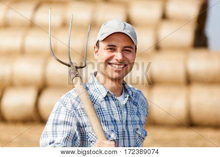 Farmer holding a pitchfork