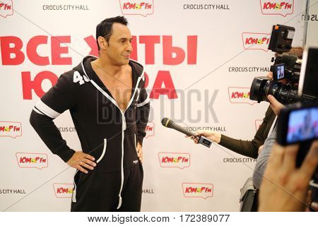 MOSCOW - OCT 9, 2016: Stas Kostyushkin singer gives interview at All hits of Humor concert in Crocus City Hall