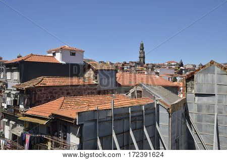 The Clerigos tower among old houses in the area around the cathedral historical centre of Porto Portugal