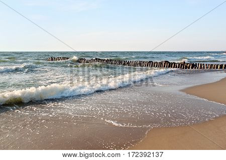 Old german breakwater on the Baltic Sea coast at summer.