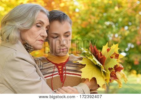 upset grandmother with grandson portrait close up