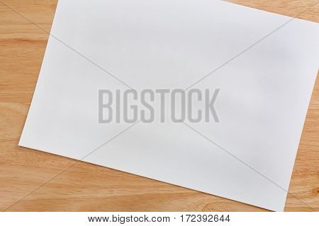 Empty white paper texture background on wood.