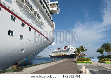 The cruise liner leaving Nassau city while other is still docked (Bahamas).