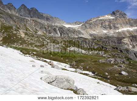 There is still some snow in late Summer in Alaska over 3000 feet above sea level (Devil's Punchbowl Skagway).