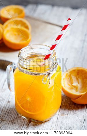 glass jar in the foreground with orange juice