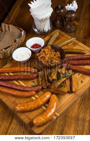 Assortment Hot Sausages Serving On Wooden Board