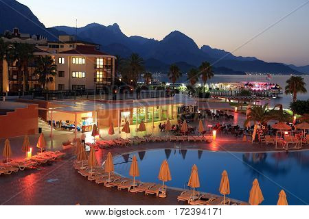 KEMER/ TURKEY - AUGUST 23. Territory of a luxury hotel in the evening on a mountains background on August 23, 2014. Kemer, Turkey.