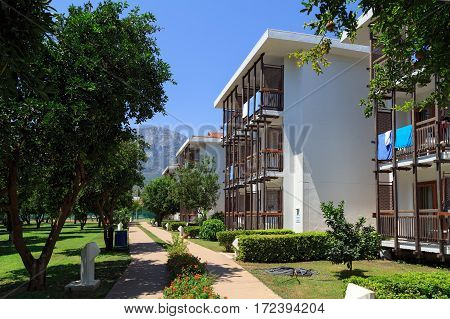 KEMER/ TURKEY - AUGUST 14. The bungalows along the alley with tangerine trees on August 14, 2014 in city Kemer, Turkey.