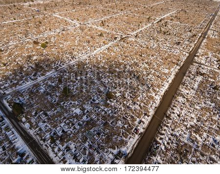 Old European cemetery in winter time. Aerial view.