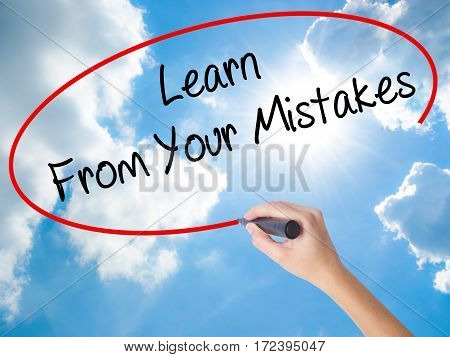 Woman Hand Writing Learn From Your Mistakes  With Black Marker On Visual Screen