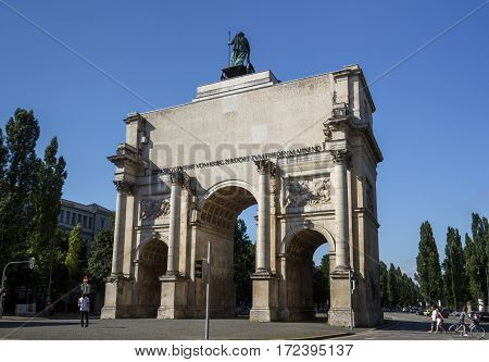 MUNICH, GERMANY - AUGUST 02, 2015: The Siegestor (Victory Gate) in Munich is a three-arched triumphal arch crowned with a statue of Bavaria with a lion-quadriga