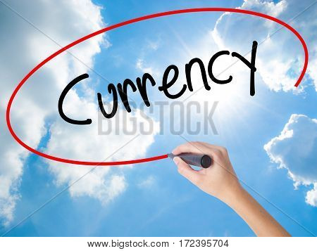 Woman Hand Writing Currency With Black Marker On Visual Screen