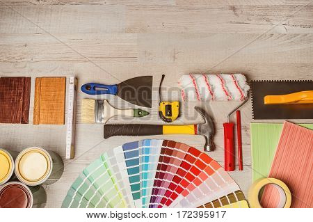 Decorating tools and samples of colors top view