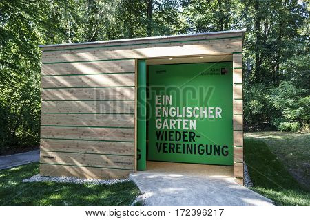 MUNICH, GERMANY - AUGUST 02, 2015: Information desk building in the English Garden aiming to reunite the park which is divided by the Isarring road into two parts