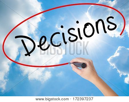 Woman Hand Writing Decisions With Black Marker On Visual Screen