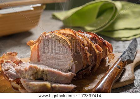Delicious Bacon wrapped pork tenderloin with steam