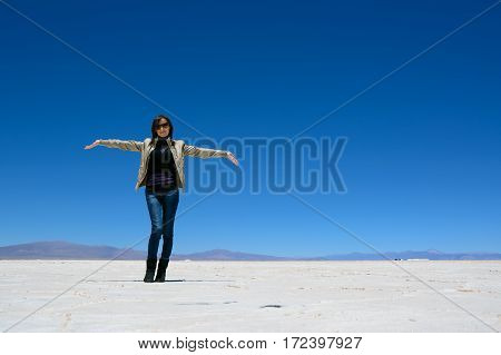 A Woman show the Salinas Grandes (Argentina)
