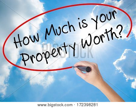 Woman Hand Writing How Much Is Your Property Worth? With Black Marker On Visual Screen