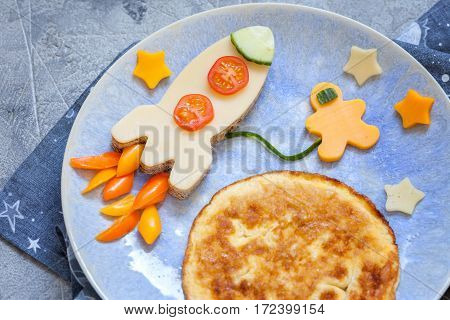 Kids funny breakfast with cheese sandwich and a omelette