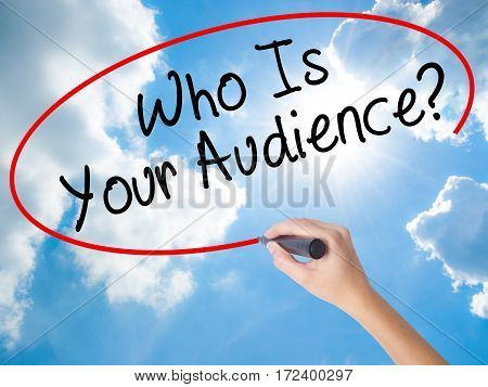 Woman Hand Writing Who Is Your Audience? With Black Marker On Visual Screen