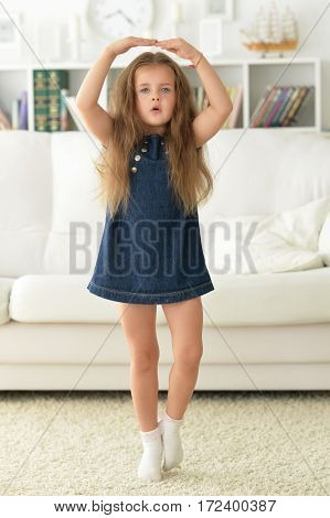 adirable little girl with beautiful long hair at home