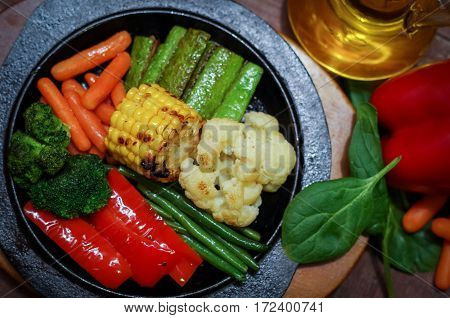 Bright colorful grilled vegetables served in a cast iron skillet