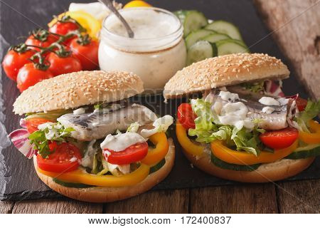 Tasty Sandwich With Herring, Sauce And Vegetables Close-up. Horizontal