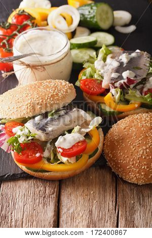 German Herring Sandwich With Sauce And Vegetables Close-up. Vertical