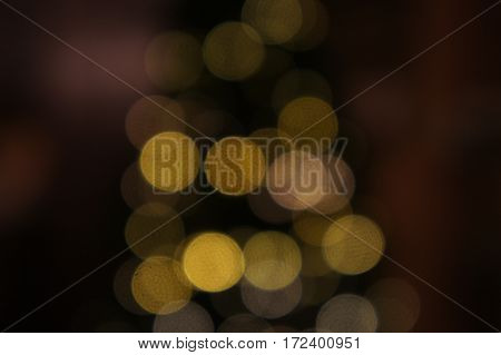 An unfocused picture of lights on a Christmas tree