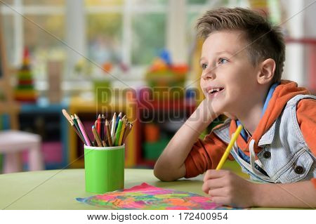 little boy doing lessons at home in his room