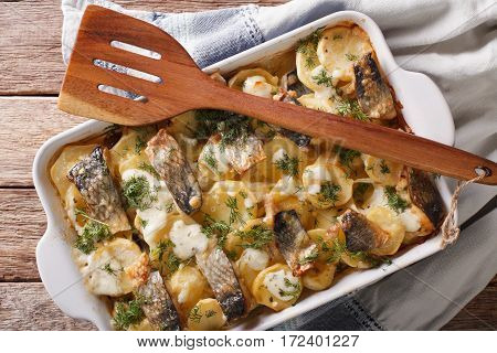 Casserole Of Potatoes, Herring In Cream Sauce In Baking Dish. Horizontal Top View