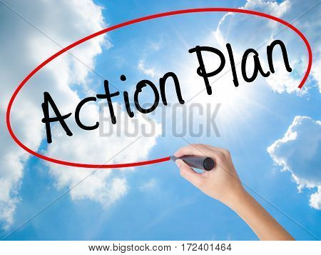 Woman Hand Writing Action Plan With Black Marker On Visual Screen