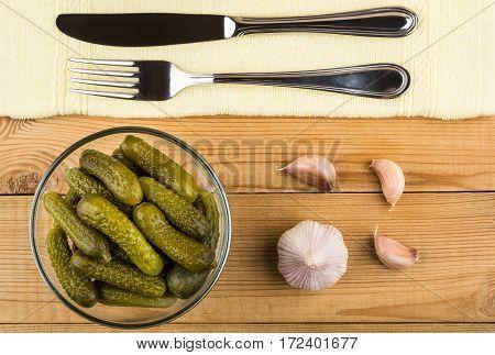 Pickled Gherkins In Transparent Bowl, Garlic, Knife And Fork
