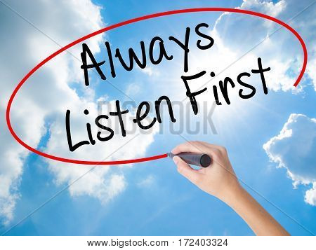 Woman Hand Writing Always Listen First With Black Marker On Visual Screen