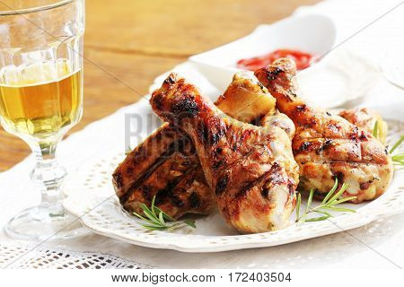 Dinner background. Grilled chicken legs with rosemary.