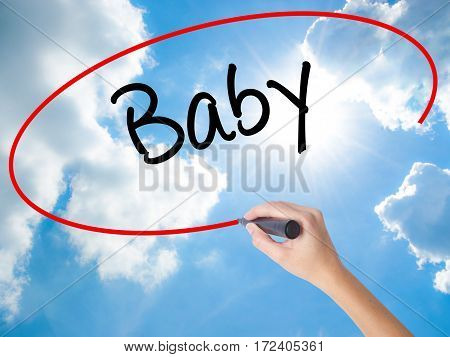 Woman Hand Writing Baby With Black Marker On Visual Screen